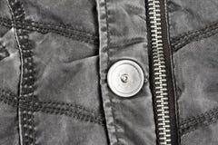Metaalmontage op gewatteerd jasje van weefsel royalty-vrije stock afbeeldingen