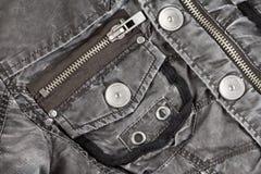 Metaalmontage op gewatteerd jasje van weefsel royalty-vrije stock foto's