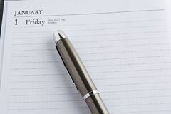 Metaalpen op een kalender Royalty-vrije Stock Fotografie