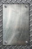 Metaalplaat op de achtergrond van de metaaltextuur Stock Afbeelding