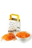 Metaalrasp en wortel die op een wit wordt geïsoleerd Royalty-vrije Stock Fotografie