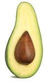 Metade de um abacate em um fundo branco Fotografia de Stock