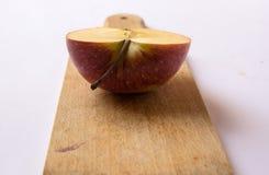 Metade de uma maçã mim Imagem de Stock Royalty Free