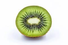 A metade do fruto de quivi isolada no branco isolou o fundo Fotografia de Stock Royalty Free