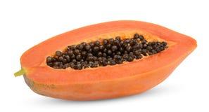 Metade do fruto maduro da papaia com as sementes isoladas no branco foto de stock