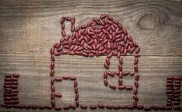 metafora della casa di eco dai fagioli rossi Fotografia Stock Libera da Diritti