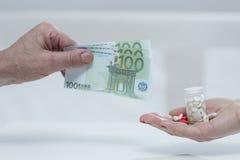Metafora di medicina costosa fotografie stock libere da diritti