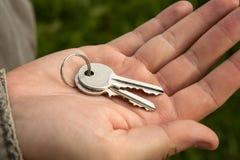 Metafora per l'acquisto di alloggi nuovi Immagine Stock
