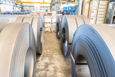Metail coils stacked in a company warehouse Stock Photography