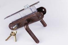 Metal аксессуары для дверей на белой предпосылке Стоковые Фото