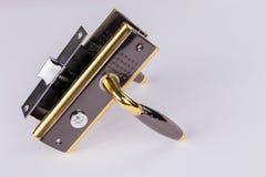 Metal аксессуары для дверей на белой предпосылке Стоковые Фотографии RF