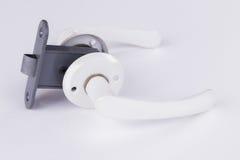 Metal аксессуары для дверей на белой предпосылке Стоковое фото RF