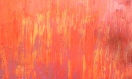 Metal текстура покрашенная в красных и желтых тонах стоковая фотография rf