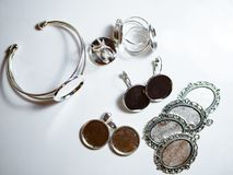 Accessories for jewelry making. Metal accessories for jewelry making. Workshop. Flat lay, top view stock photos