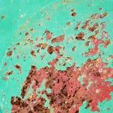 Metal aherrumbrado verde y rojo. foto de archivo