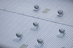 Metal Air ventilator on the roof. Stock Photos