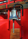 Metal alarm bell on red fire truck Stock Photo