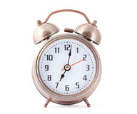 Metal alarm clock with red second hand. Royalty Free Stock Photography