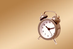 Metal Alarm clock work time 10 am. Royalty Free Stock Photography