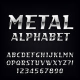 Metal Alphabet Vector Font. Oblique chrome letters and numbers on the dark background. Stock Image