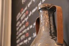 Metal Amphora and Menu Blackboard stock photo