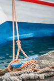 Metal anchoring bollard in Zakynthos Town. Ropes tied to the small steel anchoring bollard on the shore in the beautiful Zakynthos town, Greece royalty free stock image