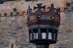 Metal ancient torch in crown shape at the entrance of Edinburgh Castle, Scotland. Scottish symbol.  royalty free stock image