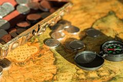 Metal antique compass and money  on background. Metal antique compass background money object decorative Royalty Free Stock Photography