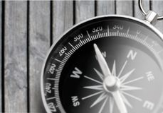 Metal antique compass on grey background. Metal antique compass background object decorative equipment Royalty Free Stock Photography