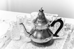 Metal Arabic teapot with glasses. Black and white photo Royalty Free Stock Photography