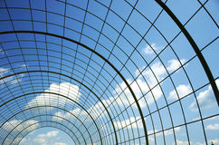 Metal arch construction. On the sky background Royalty Free Stock Photo