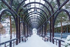 Metal arch in the park. Metal arch in the park in the winter, on the sides are benches. Metal arch in the park Stock Photography