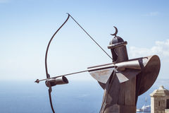 Metal Archer in the fortress of Santa Barbara. ALICANTE, SPAIN - SEPTEMBER 9, 2014: Metal Archer on the protective wall in the fortress of Santa Barbara sent an Stock Photography