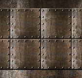Metal armour background with rivets stock image