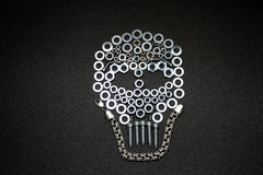 Metal art. Skull made by screw nuts, washers and bolts Stock Images