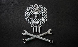 Metal art. Skull made by screw nuts, washers and bolts Stock Image
