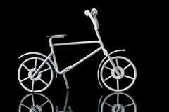 Metal artifact. Bicycle on a black background Stock Photo