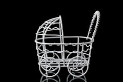 Metal artifact. Stroller on a black background Stock Images