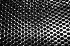 Metal background. A simple metal background with holes Stock Image