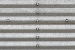 Metal background. With bolts - closeup of building siding Stock Image