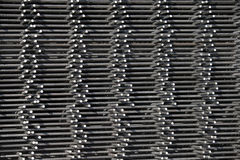 Metal background. A background image of metal stacked and lined up Stock Image