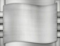 Metal background of brushed steel plate with reflections Stock Image