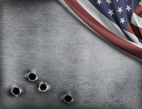 Metal background with bullet holes and USA flag Royalty Free Stock Photos
