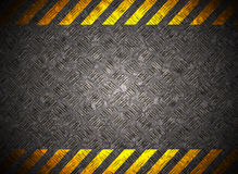 Metal background with caution tape Royalty Free Stock Image