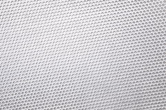 Metal background with circular holes Royalty Free Stock Photo