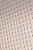 Metal background with circular holes Stock Photography