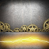 Metal background with cogwheel gears and electric lightning Stock Image