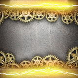 Metal background with cogwheel gears and electric lightning Royalty Free Stock Photos