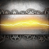Metal background with cogwheel gears and electric lightning Stock Photo