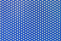 Metal background Grid circles. Sheet metal with a grid of circles dip blue color Stock Photography